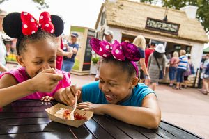 Epcot guests sample tasty bites from the Cider House Outdoor Kitchen during the Epcot International Flower & Garden Festival. The festival, which runs 90 days March 1-May 29, 2017 at Walt Disney World Resort in Lake Buena Vista, Fla., features dozens of character topiaries, stunning floral displays, gardening seminars and the Garden Rocks concert series - all included in regular Epcot admission. (Matt Stroshane, photographer)