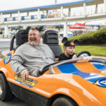 Multiplatinum recording artist, actor and comedian Daniel Lawrence Whitney, also known as ÒLarry the Cable Guy,Ó and his family take the cars for a spin at Tomorrowland Speedway at Magic Kingdom Park in Lake Buena Vista, Fla., Monday, Jan. 8, 2018. (L-R, front, back): Daniel Lawrence Whitney, his son Wyatt Whitney, wife Cara Whitney and daughter Reagan Whitney. Whitney, who voiced Mater, the friendly tow truck in the Disney¥Pixar ÒCarsÓ movies, is vacationing with family at Walt Disney World Resort. (Matt Stroshane, photographer)